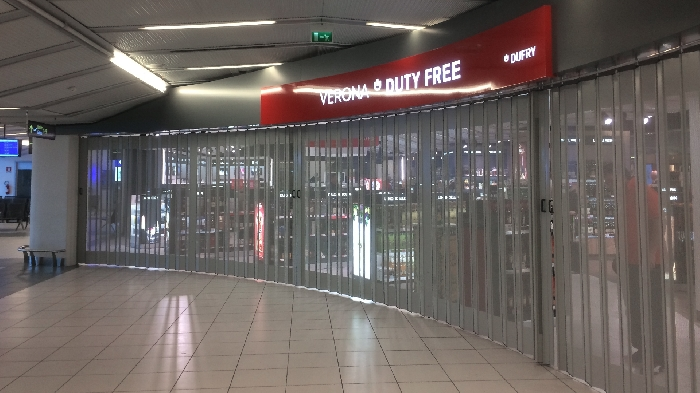 Protector sliding folding shutter FoldingPack®. Closure for Airport commercial areas